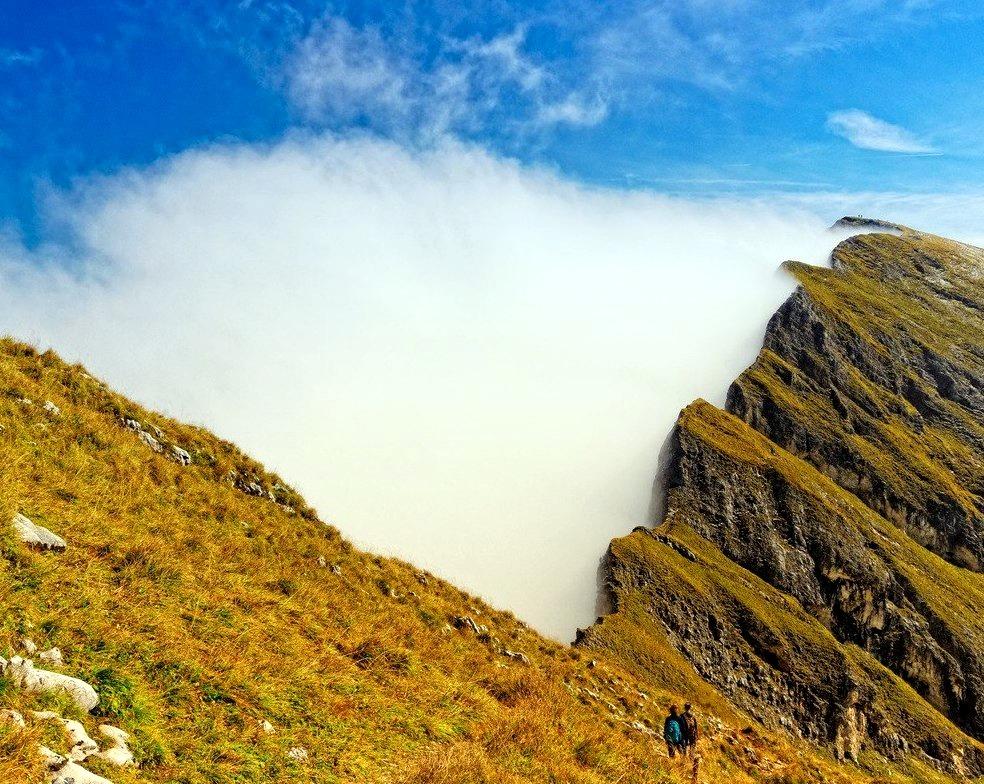 Clouds sticking to mountain cliffs in Tyrol, Austria